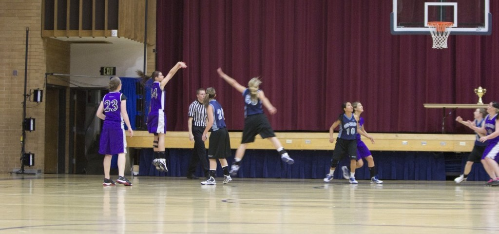 A Freeze team member, in purple, shoots in the championship game against the Thunder, in blue. ALEXA COLLETT   Scroll Photography