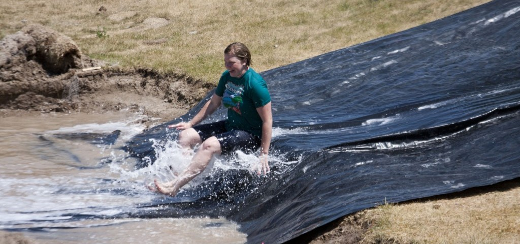 Melanie Meik, a junior studying art history, slides down the slip and slide on July 7. The BYU-Idaho Wellness Activities set  the slip 'n slide by the 
