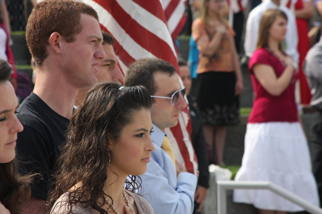 Students and faculty gather together to pay tribute to those who died in 9/11. Members of the ROTC presented the flags and the National Anthem was sung followed by a moment of silence. EMMILIE BUCHANAN | Scroll Photography