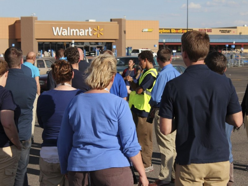 Walmart employees wait in the parking lot as police investigate a bomb threat on Sept. 15. The threat started when a prank call was made to Walmart management, warning them of two bombs contained within backpacks in the store. TIM CARTER | Scroll Photography