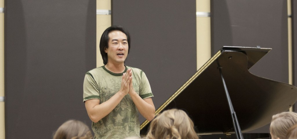 TOP: Alpin Hong talks with students about his musical background and shares his passion about his music with the audience members. He performed at the Barrus Concert Hall on Sept. 28.  AKITA LAGAZO | Scroll Photography