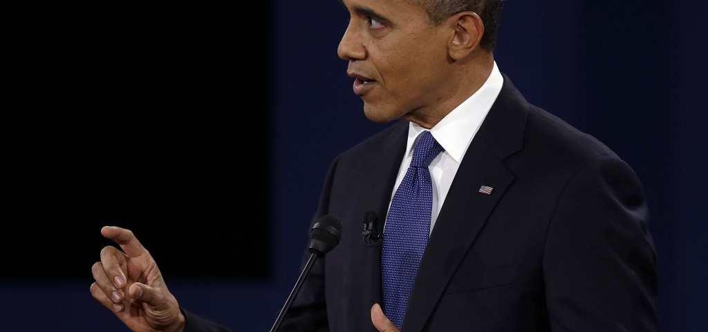 President Barack Obama speaks at a presidential debate before the election. According to the Obama campaign memo, the president plans to reduce the national deficit by more than $4 trillion. AP PHOTO