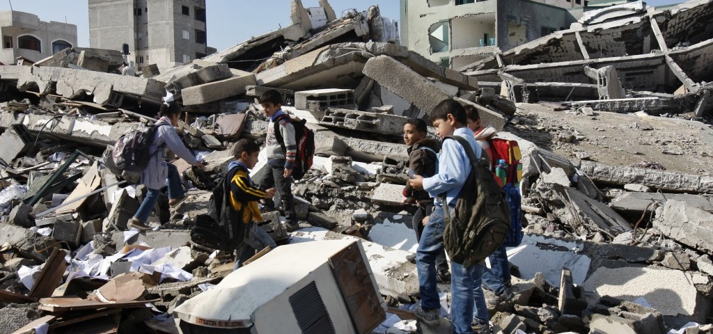 Palestinian school children walk in the rubble on Nov. 26 after an Israeli strike destroyed the Hamas interior ministry in Gaza City. Israel launched its offensive on Nov. 14 in a bid to halt months of Palestinian rocket attacks. It says it inflicted heavy damage on Gaza militants, but the territory's armed gros fired hundreds of rockets into Israel before a cease-fire was declared Nov. 21. AP PHOTO