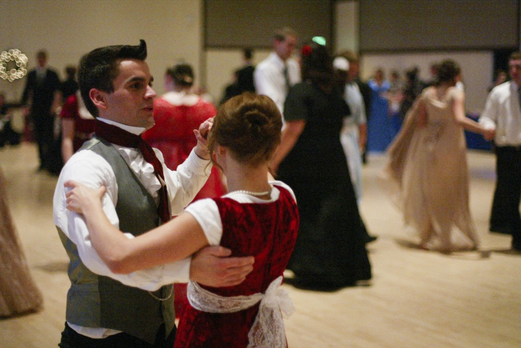 Students dress  in 19th century attire as they attend the Jane Austen Yule Ball on Nov. 30 in the Manwaring Center. Students also came out of comfort zones while dancing as characters in Austen's novels would have. RENAE GRILLIOT | Scroll Photography