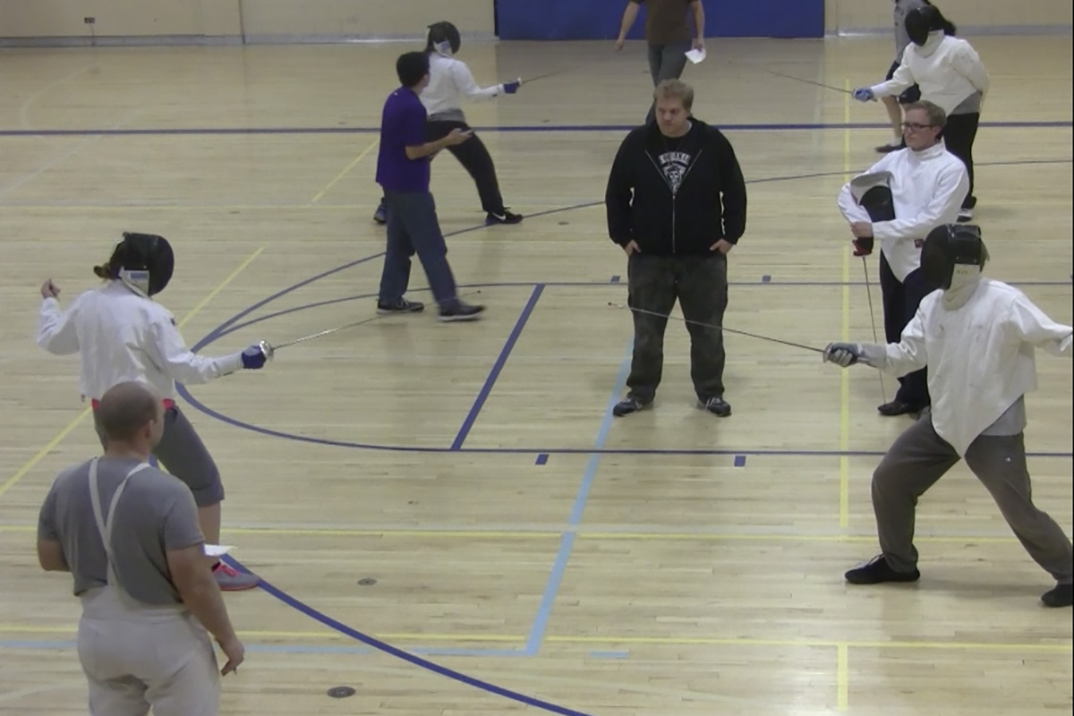 Students participate in fencing club