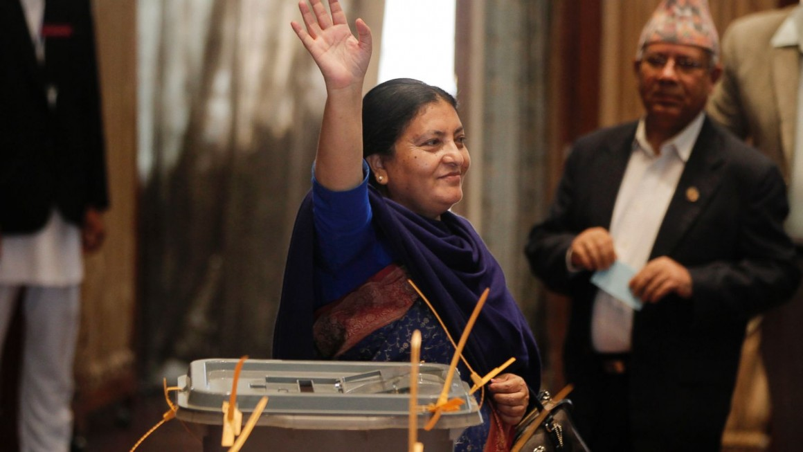 Presidential candidate and vice-chairperson of the Communist Party of Nepal (Unified Marxist-Leninist) Bidhya Bhandari waves her hand after casting vote as lawmakers vote for a new president in Kathmandu, Nepal, Wednesday, Oct. 28, 2015. The prime minister is Nepal's leader, while the president is the ceremonial head.The new constitution adopted last month requires Nepal to name a new president.