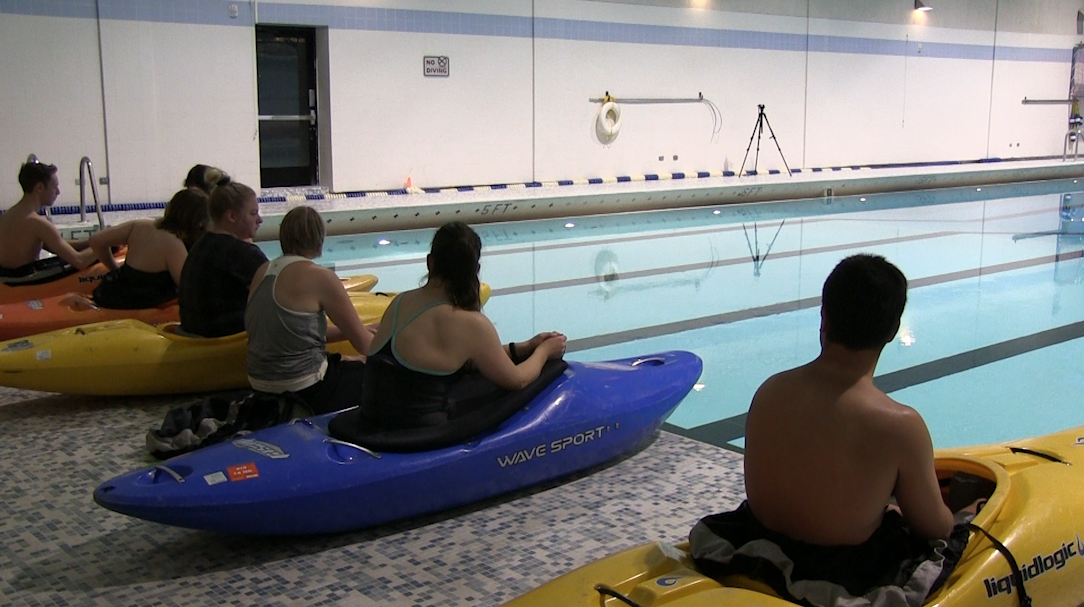 Students roll into open pool kayak