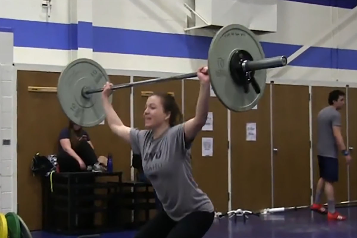 Athletes get yoked during Olympic weightlifting competition