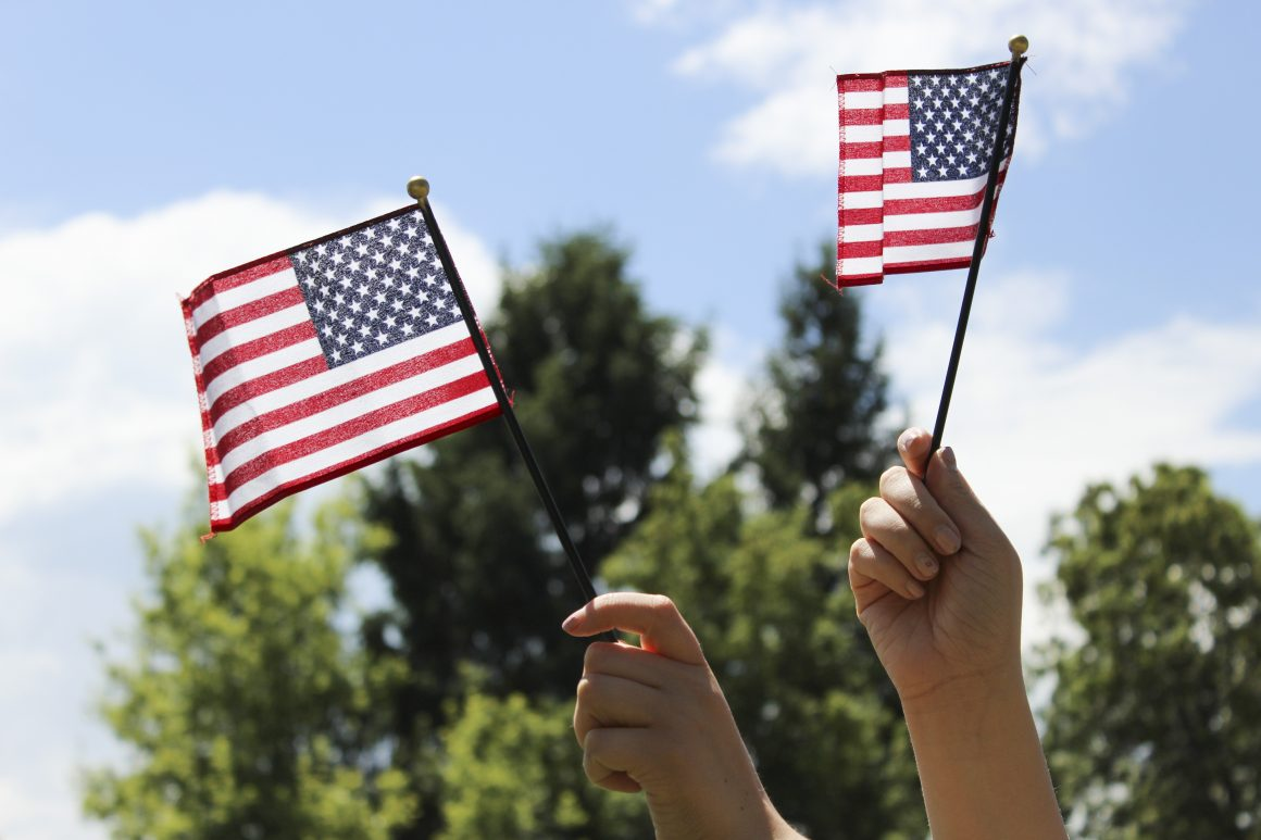 BYUI student waves American flags around excited for the fourth. (Taylor Lowder)