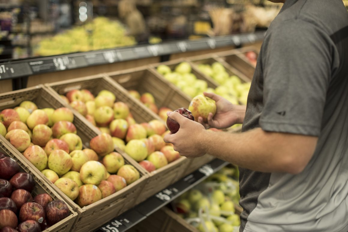 BYU-Idaho student looking for the best option on produce. (Logan Peterson, Scroll Photography)
