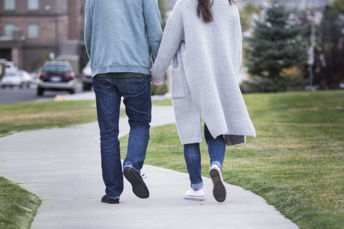 Couple holding hands (Brooks McFadden, Scroll Photography)