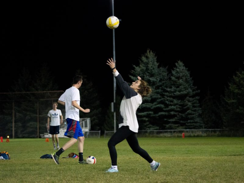 BYUI students pump it up at co ed grass volleyball (Valerie Fisher)