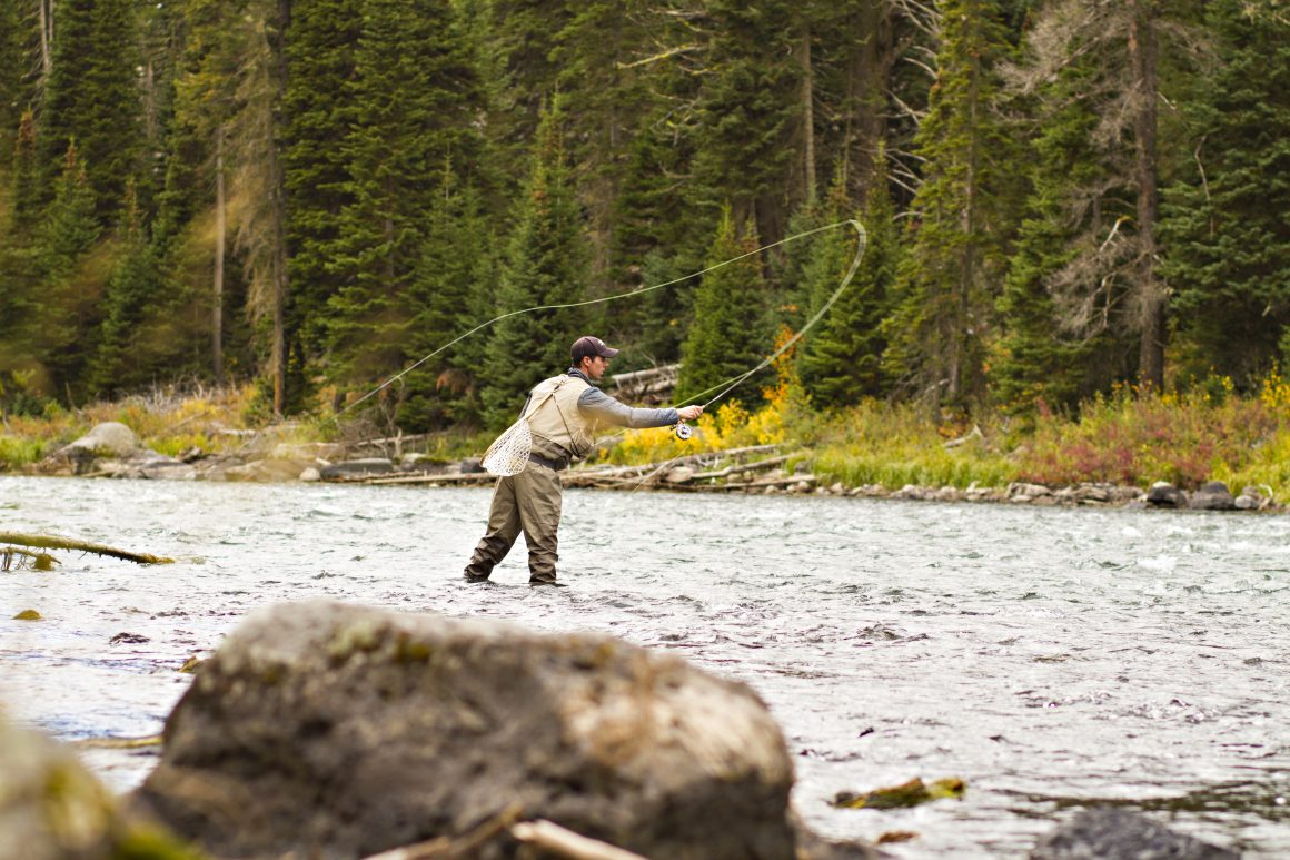 Andrew Bosselman, an exercise physiology major, in his junior year, casting his wet fly-fishing line, Box Canyon, Island Park (Deanna Port, deannapaigephoto)