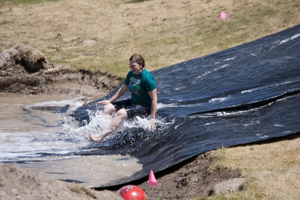 Students cool down on slip and slide