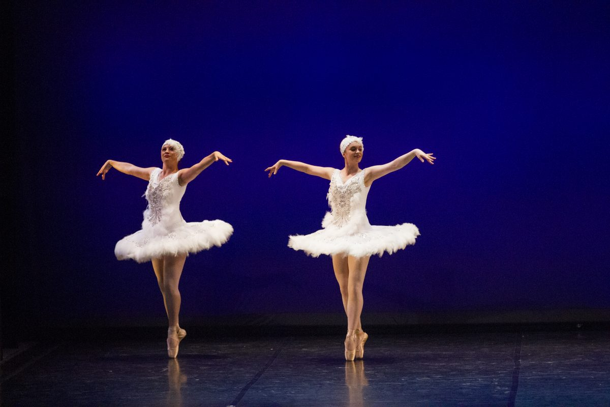 two members of dance alliance perform on stage in the spring 2017 extravadance performance