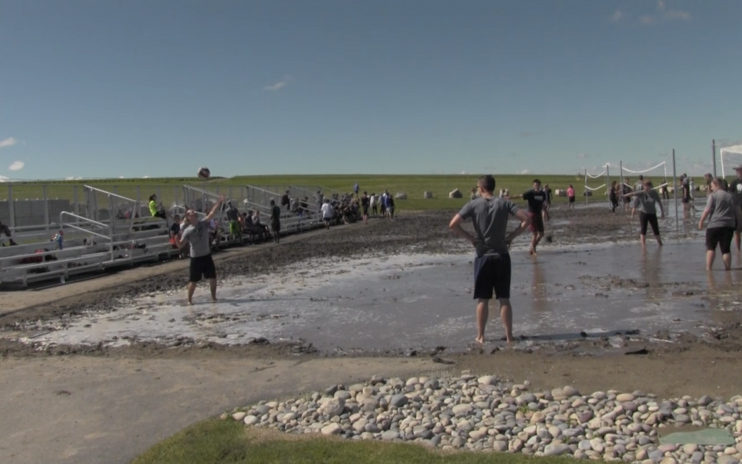 WATCH: Students slip into mud volleyball