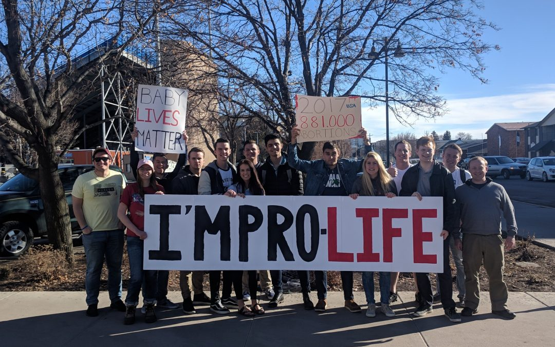 Change their minds — off-campus groups debate abortion, border wall and more