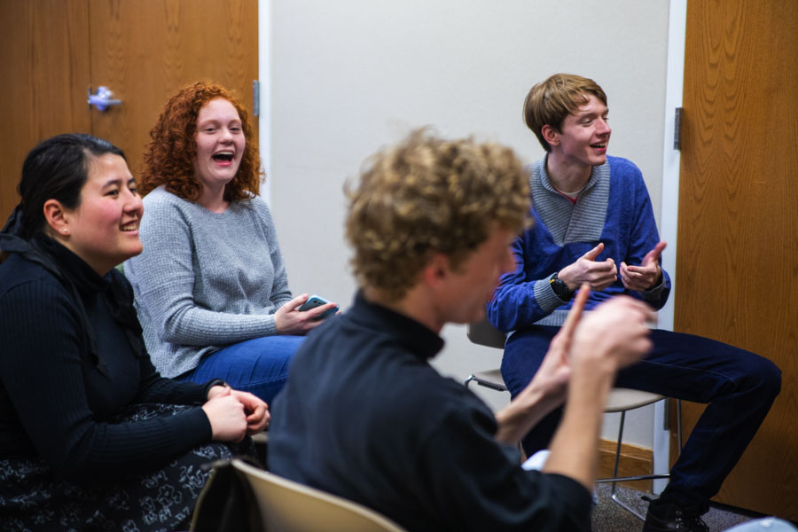 Students laughing at some unspoken joke.