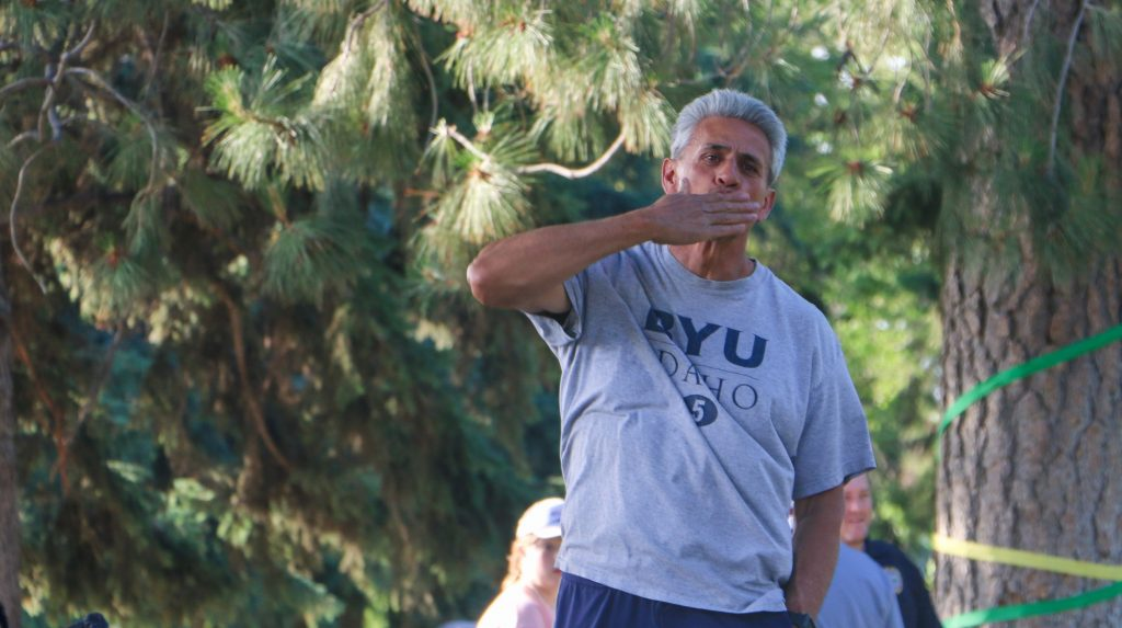 William Riggins, the Chief Inclusion Officer for BYU-Idaho blows a kiss to the audience after being recognized.