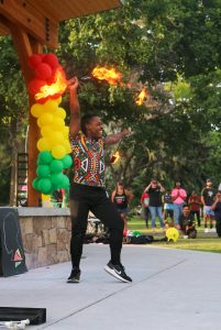 A baton twirler performs for the crowd.