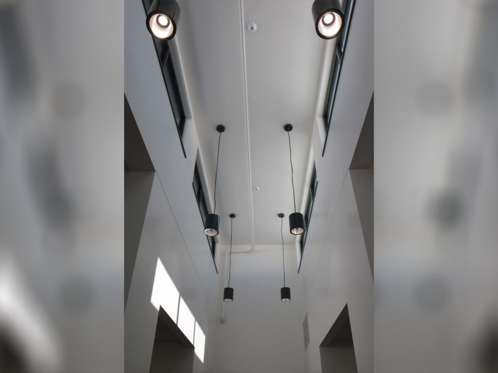 Lighting in a hallway leading to the lockers.