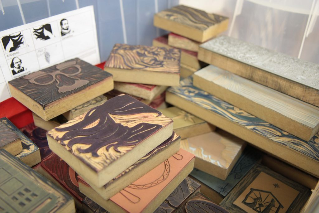 Various wood blocks are used to create images. Prior to the invention of the Gutenberg Press, wood blocks were the most common way to mass produce images or literature.