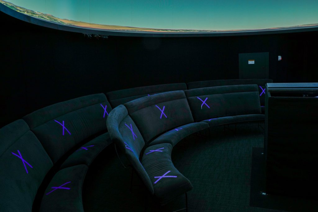 Social-distance seat markers in the planetarium to watch the night sky while following school guidelines.