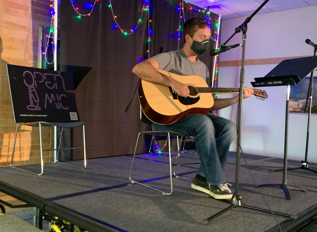 A student performs on guitar at Open Mic Night.