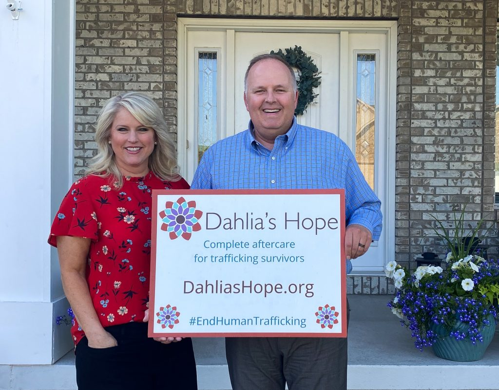 Dean and Kristin Coleman holding a Dahlia's Hope sign