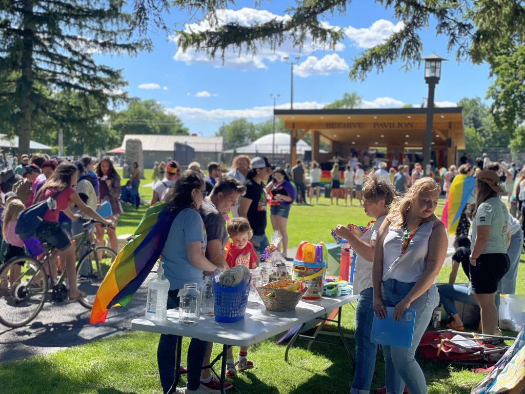 Community members gathered at Porter Park for the Pride event.
