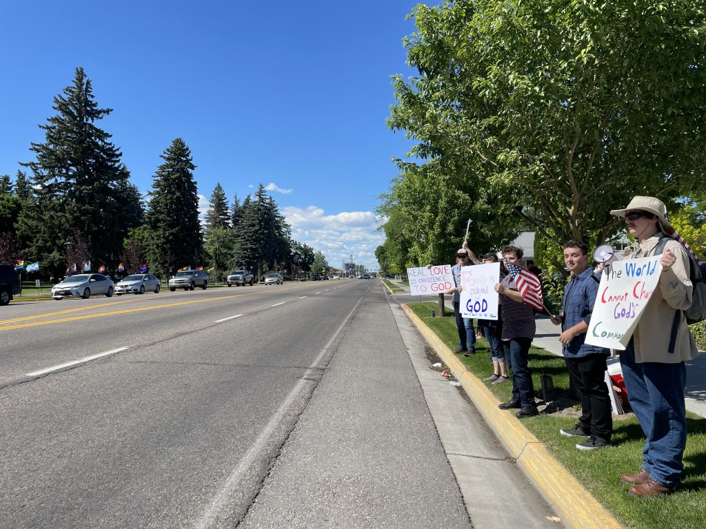 The Family Values for America group standing outside of the Rexburg Deseret Book during the Flourish Point Pride event.