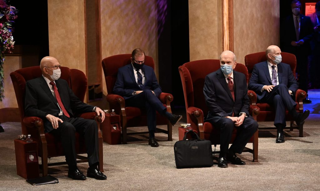 Church leaders wear masks during General Conference