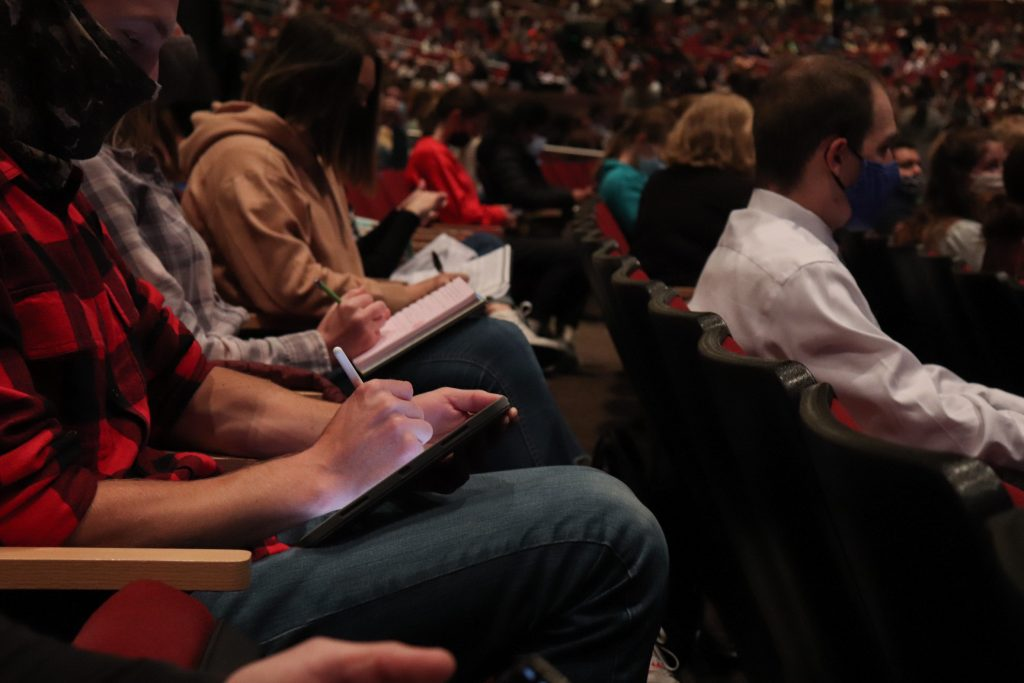 Students took notes on notebooks, tablets and phones during devotional.