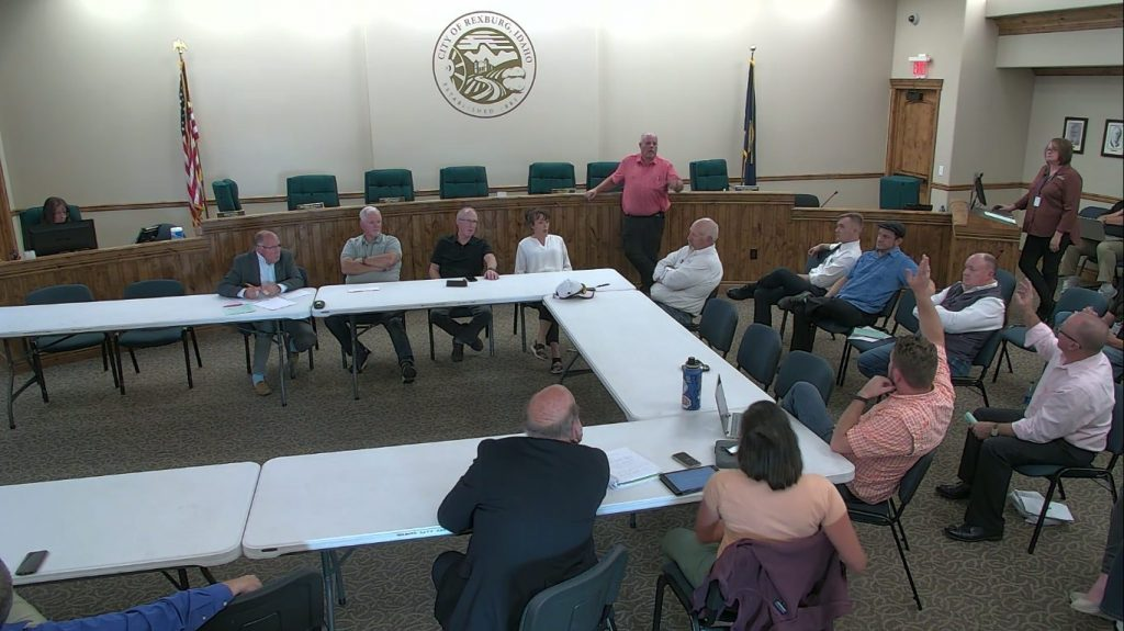 City Planning and Zoning Coordinator Alan Parkinson and City Council members, Christopher Mann, Mikel Walker, Tisha Flora, Brad Wolfe and Bryanna Johnson converse with Rexburg Residents about laws surrounding mobile food vendors.